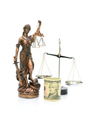 statue of justice and money on a white background. vertical phot