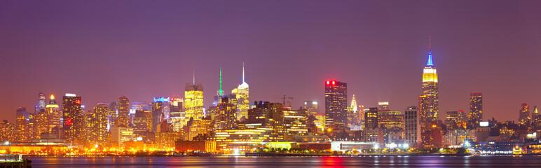 New York City, USA colorful night skyline panorama