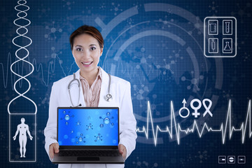 Beautiful scientist hold laptop on blue background