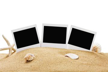 photo frame on the sea sand isolated