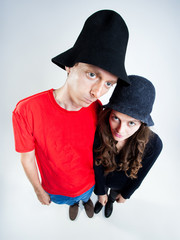 funny couple wearing peasant hats in the studio