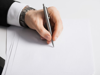 businessman writing something on the paper
