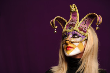 woman in violet party mask