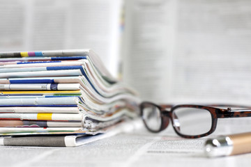 Newspapers and magazines blurred background concept