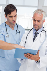 Two doctors talking about a file