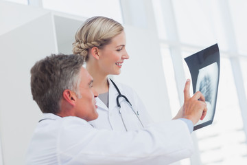 Medical team examining a radiography