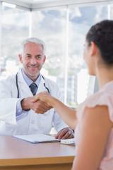 Patient shaking hands to doctor