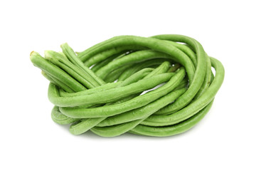 Green lentils,beans tied and coiled on white background