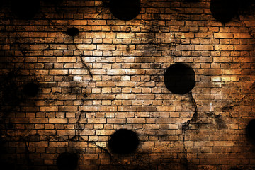 Old brick wall with bullet holes