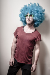 hipster stylish funny man with blue wig