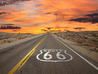 Tuinposter Route 66 Route 66 Pavement Sign Sunrise Mojave Desert