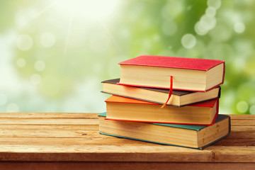 Old vintage books over beautiful bokeh background