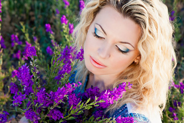 close-up of beautiful young woman with violet flowers