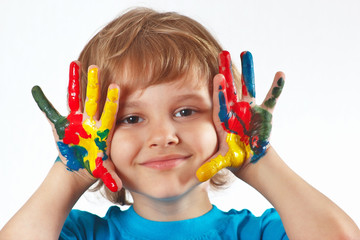 Little boy with painted hands on a white background