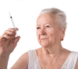 Old  woman preparing syringe for making insulin injection