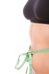 woman slim stomach with measuring tape around it