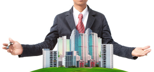 business man and modern building on green grass field