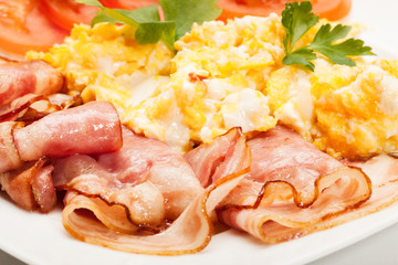 Closeup of scrambled eggs with bacon