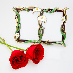 picture frame and red roses