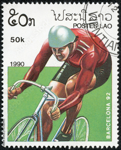 Wall mural stamp printed by Laos, shows bicycling