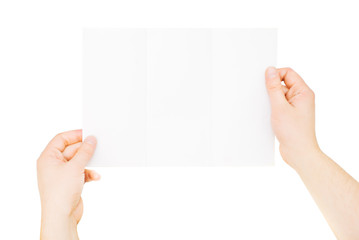 Hands holding trifold empty brochure, slightly folded, isolated