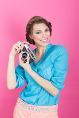 Cute retro young woman with analogue camera