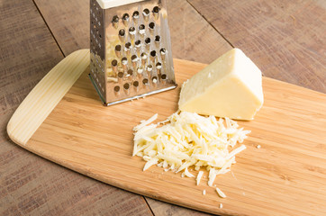 Parmesan cheese grated on a cutting board