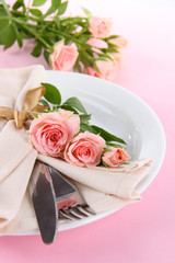 Served plate with napkin and rose close-up