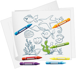 A paper with a drawing of sea creatures and crayons