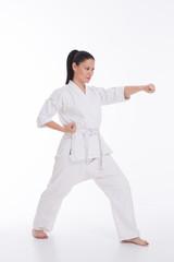 Beautiful woman in kimono show marshal art exercise on white