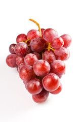 Sweet pink grapes isolated on white background