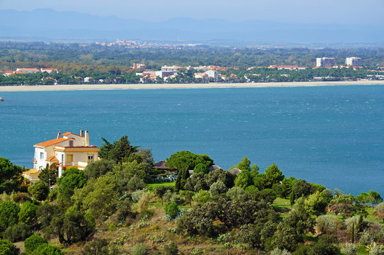 Villa above the Mediterranean sea with the town of Argeles sur Mer in background, Roussillon, Pyrenees Orientales, France