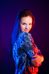 beautiful woman portrait in blue and red light