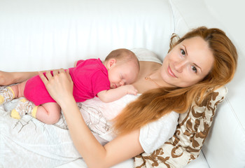 mother and her child baby sleeping lying on her stomach