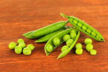 Sweet green peas on wooden background