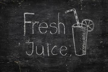 Chalk on black board: Fresh Juice