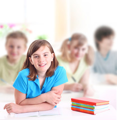 Portrait of teenage girl in classroom.