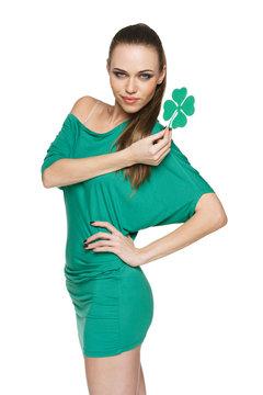 Woman wearing green dress showing green shamrock leaf