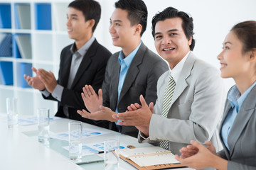 Applauding businessman
