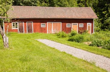 Old barn in a romantic garden.