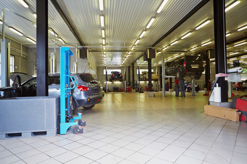 Cars in workshop of service station