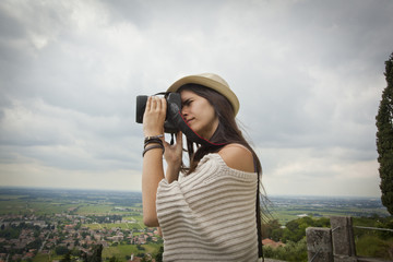young beautiful woman photographing landscape