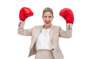 Cheering businesswoman with boxing gloves