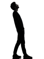handsome african young man standing looking up surprise silhouet