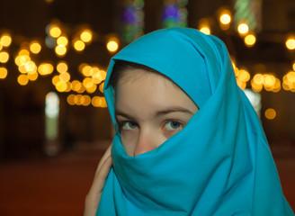 Teen muslim girl at a mosque