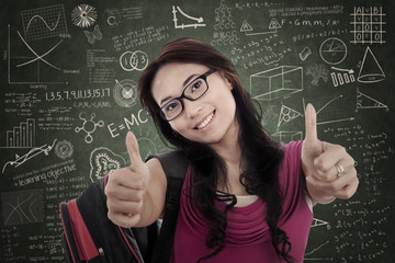 Asian female student give thumbs up in class