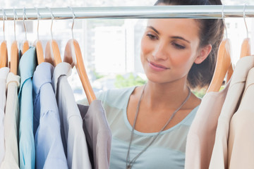 Attractive fashion woman looking at clothes