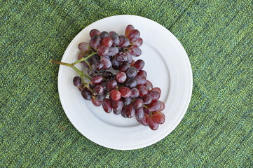 Grapes in a white plate