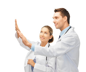 young doctors working with something imaginary