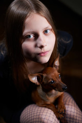 Portrait of a teen girl with dog